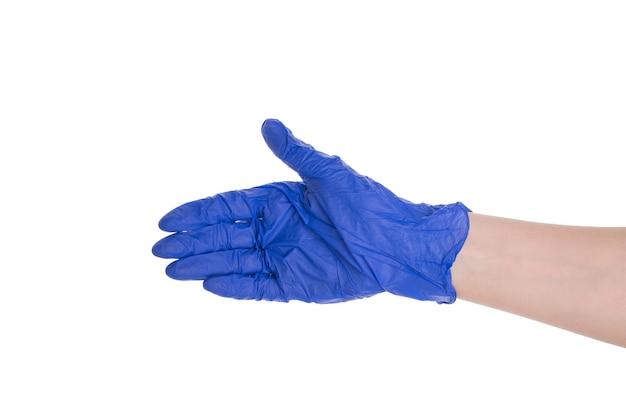 患者の概念に手を伸ばす医師。白い背景の上に分離された鮮やかなニトリル手袋で手のプロファイル側面写真をクローズアップ