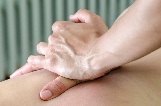 Physitoterapist / chiroprator doing a back massage. osteopathy