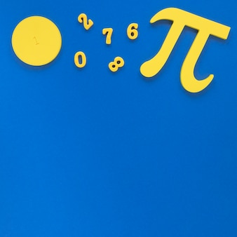 Pi symbol and numbers on blue copy space background