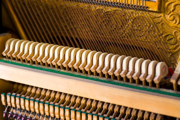 Piano instrument inside, antiquary piano and old mechanism, close-up