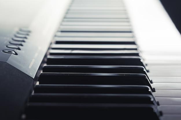 Piano keyboard closeup, side view