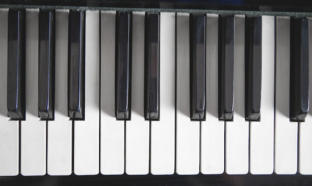 Piano keyboard. white and black. music