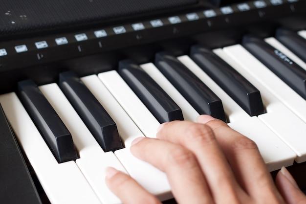 Piano keyboard with woman