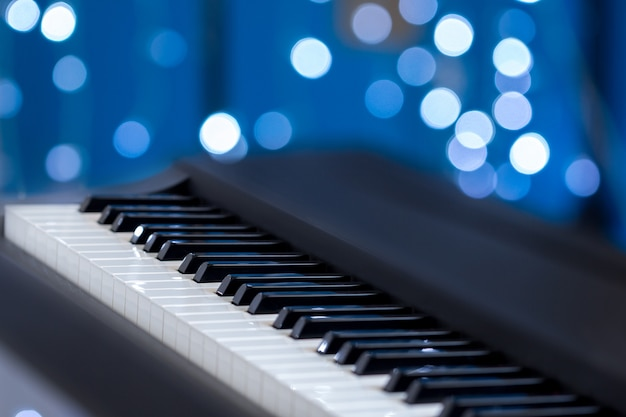 Piano keys on a blue bokeh