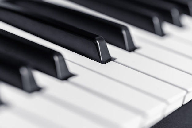 Piano keys close up view. classical music instrument for playing
