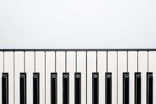 Piano keys with copy space, isolated for design, top view, flat lay.