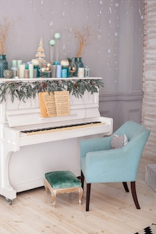 Piano in room decorated candles for christmas