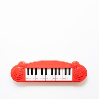 Piano toy on white background with copy space