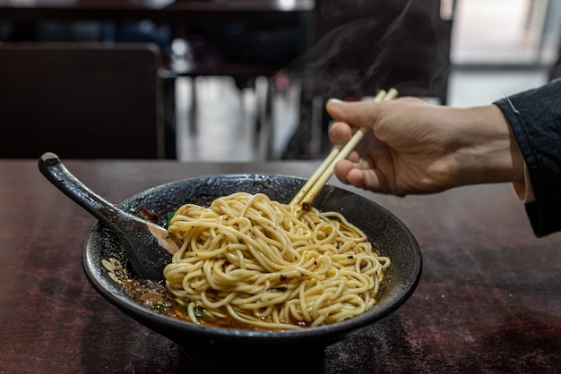 Pick up chinese food with chopsticks