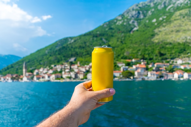 Pick up toast and drink beer, sailing on a yacht along the boka kotorska bay.