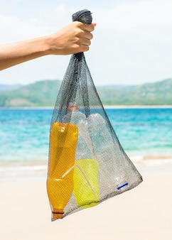 Picking plastic up from the beach recycle