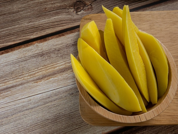 The  pickled mango thailand   in bowl on wood table for food content.