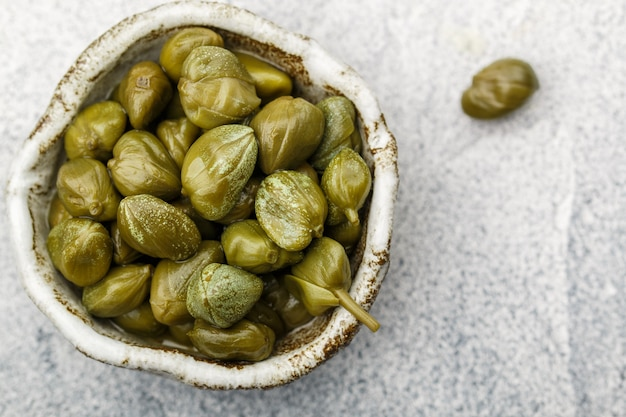 Pickled or salted capers in a bowl