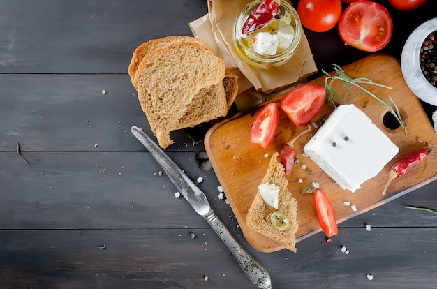 Pickled soft cheese, bread and tomatoes