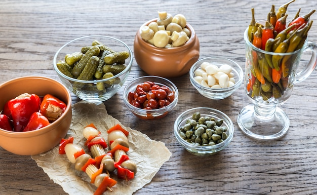 Pickled vegetables on the wooden surface