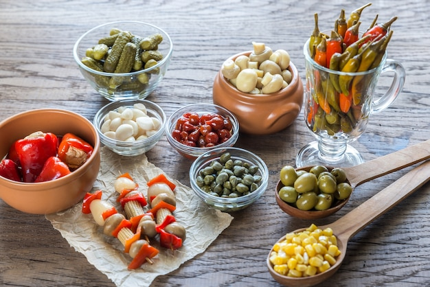 Pickled vegetables on the wooden table