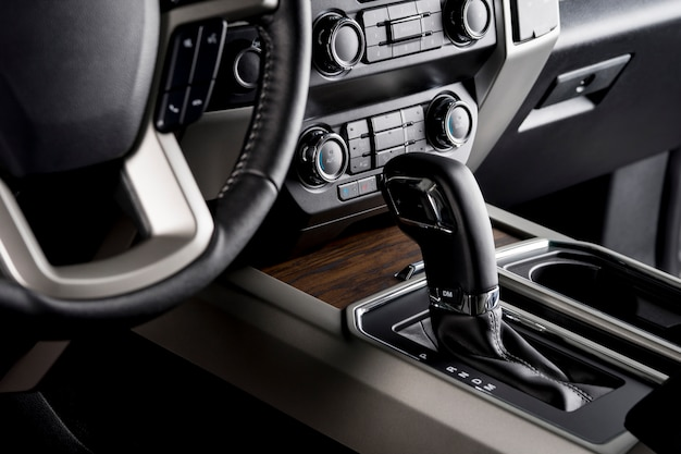 Pickup truck with the most luxurious interiors, automatic gear lever close up, designed for comfortable driving