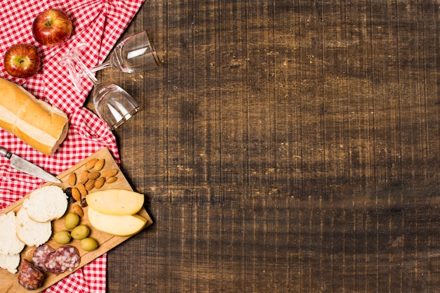 Picnic assortment on wooden background with copy space