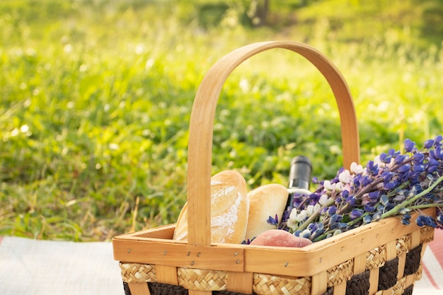 Picnic basket on the background of bright summer grass
