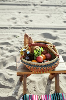 Picnic basket filled with snacks and drinks at the beach