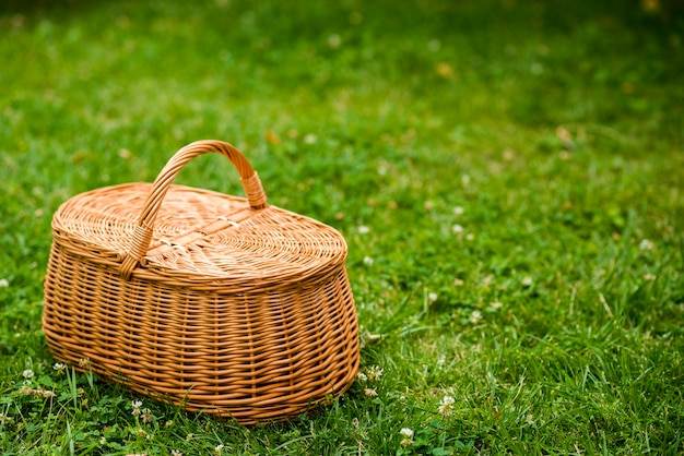 Picnic basket on a grass field