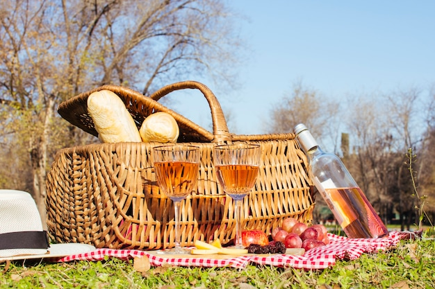 Picnic basket with bottle of white wine
