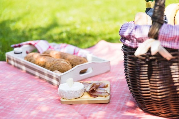 Picnic breakfast on table cloth in the grass