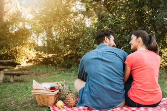 Picnic concept with backview of couple