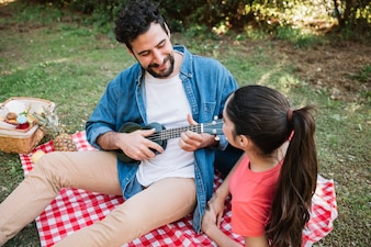 Picnic concept with couple and guitar