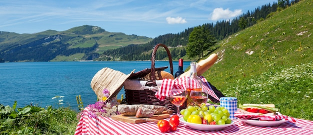 Picnic in french alps with lake, panoramic view