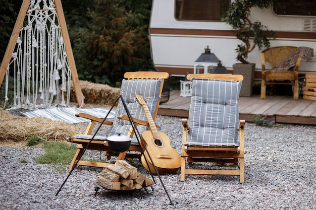 Picnic in the garden by the fire with a guitar