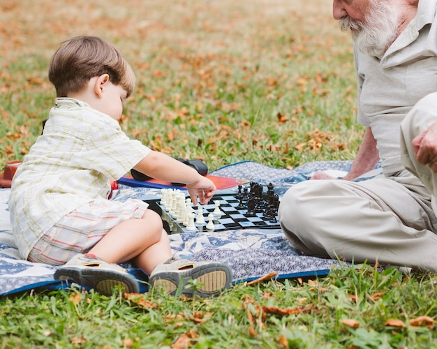 Picnic in park grandspa with grandson