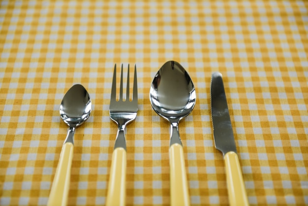 Picnic set. cutlery, tablecloth, basket, spoons, forks, knives, glasses, napkins. romantic date. family weekend. yellow cell. perfect family. narcissuses. a frame for text or photo.