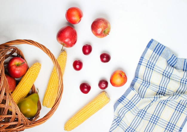Picnic setting with fruit on white background. rustic style junket.