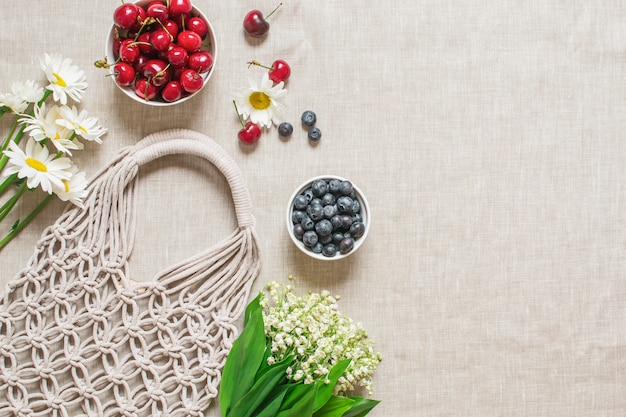 Picnic time. handmade macrame bag on linen background,