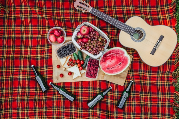 Picnic with watermelon and other fruits on nature, guitar, nobide