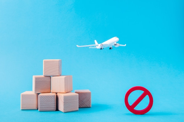 Picture of aircraft plane fly pile stack cubes carry abroad prohibition sign