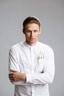 Picture of attractive caucasian man with money in a pocket