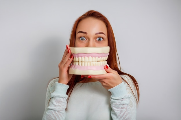 Picture of attractive female dentist patient with big jaws.