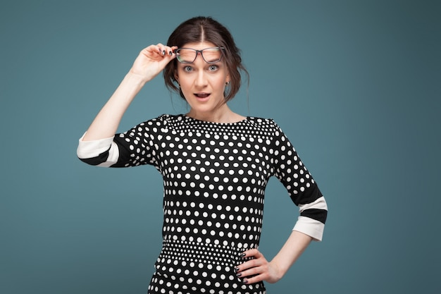 Picture of attractive woman in speckled clothes standing
