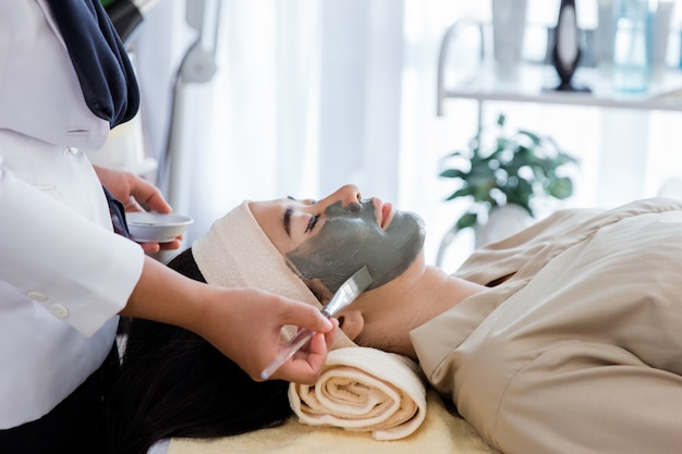 Picture of beautician doing facial mask