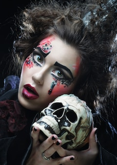 Picture a beautiful fantasy woman with skull. halloween theme.