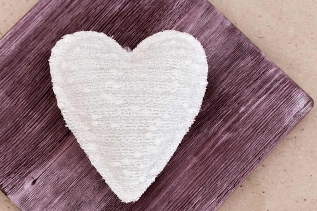 Picture of beautiful handmade white heart, soft heart toy. homemade gift. cute present. love concept.