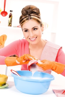 Picture of beautiful housewife washing dish at the kitchen