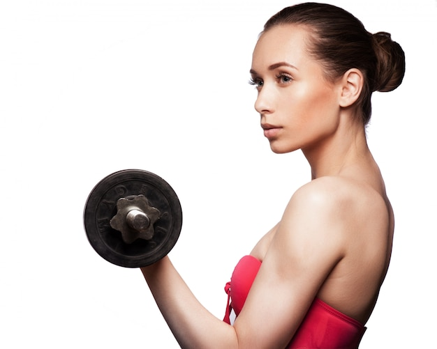 Picture of beautiful sporty woman with dumbbell