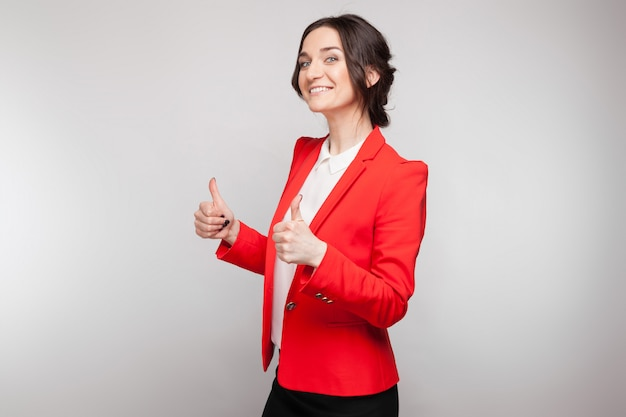 Picture of beautiful woman in red blazer standing