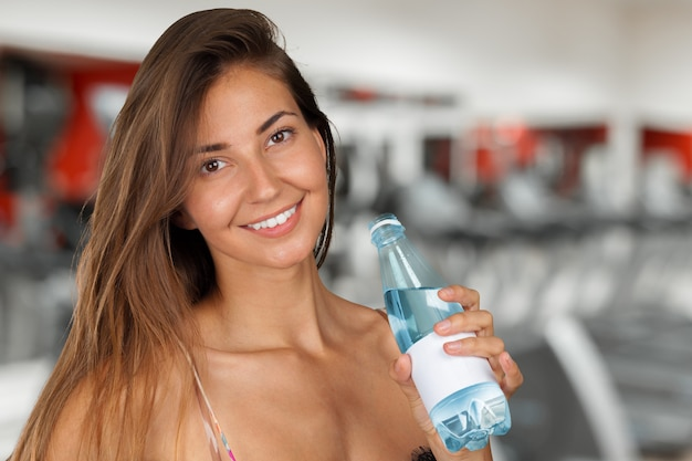 Picture of beautiful woman with bottle of water