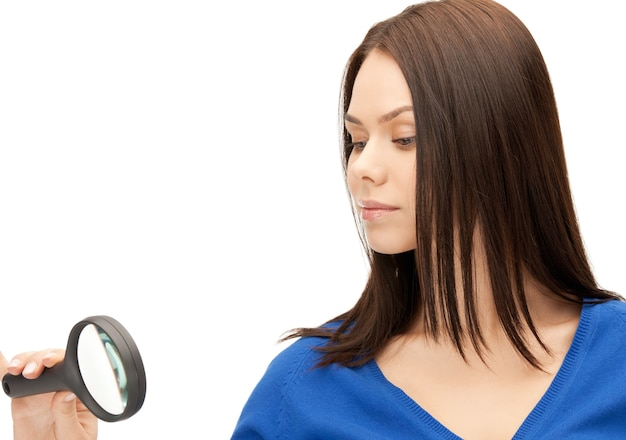Picture of beautiful woman with magnifying glass...