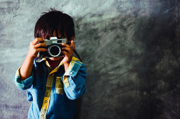 Picture of a boy holding a camera