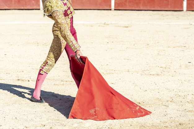 Picture of a bullfighter or matador in traditional clothes and red fabric